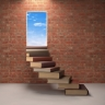 Books leading to open door in brick wall.
